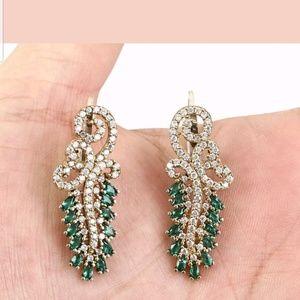 Emeralds & white sapphire fancy earring